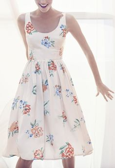 Soft blooms adorn this sweet feminine summer dress.
