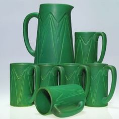 Rookwood Pottery tankard and mug set, with a mat green glaze, 1905. Over a hundred years old and this set still looks decidedly modern.