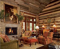 Walls and ceilings of salvaged wood offset the sophistication of the great room's furnishings and art—put together by interior designer Suzanne Kasler—including an unsigned late-19th-century painting, a George III sideboard and chinoiserie tables. Stark sisal carpet. Lee Jofa drapery fabric.