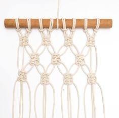 DIY mini macrame wall hanging: creating diamond shape using square knots.
