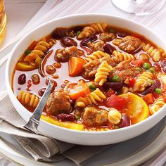 Sausage Pasta Stew Recipe -I rely on my slow cooker to prepare this chili-like specialty. It's packed with turkey sausage, pasta and vegetables. My gang gobbles it up without realizing they're eating healthy. —Sarah Bowen of Upland, California