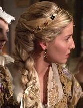 Good Page for Tudor Costume history and lots of pictures.  Mostly hats, snoods, crowns, veils, and various other things like that.  Not much on dresses.