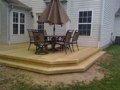 Deck Ideas | Raised wood deck designed with step-down surround