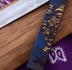 Tiger and moon friction folding knife by tiaanburgermetalart