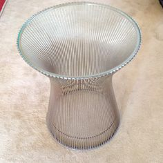 "$550 Warren Platner for Knoll side table 3/8 glass top with nickel plated steel rod base. Clear extrusion ring on bottom. 15 3/4 wide, 18"" tall."