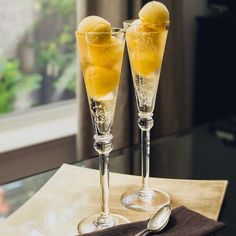 Mango sorbet floats. Very easy delicious dessert with mango and champagne.