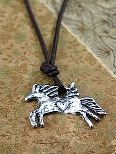 """Release your inner Cowgirl with the Unbridled Spirit #necklace.  The soaring soul of the wild horse is shown in this pendant that features a winged equine on leather with the words """"free spirit"""" carved on the back.  #handmadejewelry  #horse  #horsenecklace  #freespirit  #horses  #cowgirljewlery  #cowgirljewelry #necklaces #jewelry #handcrafted  islandcowgirl.com"""