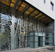An organic motif was also used when designing this metal screen facade. It was carved to resemble trees and branches and to be reminiscent of a forest for Victoria Center/Bucharest. Architecture Design, Facade Design, Wall Design, Exterior Design, Installation Architecture, Architecture Interiors, Chinese Architecture, Architecture Office, Futuristic Architecture