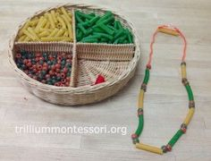 Necklace making with pasta and beads at Trillium Montessori Space saver wire shelf for weaving.
