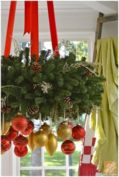 a gorgeous Christmas chandelier of evergreens, gold and red ornaments and red ribbons is amazing for holiday decor - DigsDigs Christmas Kitchen, Noel Christmas, Christmas Lights, Christmas Wreaths, Christmas Crafts, Christmas Ideas, Black Christmas, Modern Christmas, Scandinavian Christmas