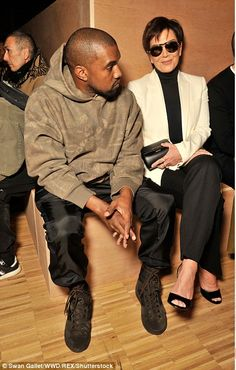 His own style rules: Kanye kept things casual in a hoodie and shiny trousers which he teamed with brown suede high-tops - he recently showed his Yeezy Season 3 collection at New York Fashion Week at Madison Square Garden