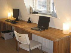 Hack a couple of Ikea 'Numerar' kitchen worktops into a 3 meter long oak desk.