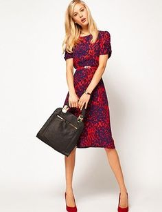 Go ahead and wear a loud print, as long as it's got a conservative cut. It's a compromise. MIDI DRESS IN ANIMAL PRINT, $76.37, ASOS.COM