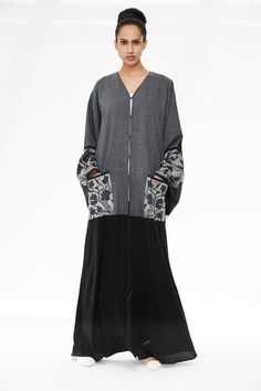 Arabesque kimono cut abaya embellished with flower shadow hand embroidery on sleeves and pockets in combination with grey paisley and plain grey fabrics. Eid Outfits, Modest Outfits, Fashion Outfits, Fashion Ideas, Fashion Inspiration, Abaya Fashion, Muslim Fashion, Morrocan Fashion, Kaftan Abaya