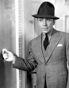 1933. George Raft and the single-breasted, peaked lapel three piece glen check suit.