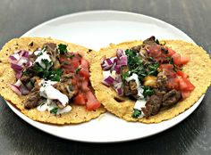 Quick and easy 10-minute Instant Pot pressure cooker steak tacos (carne asada) are a healthy and skinny meal loaded with salsa, cilantro, and juicy steak.