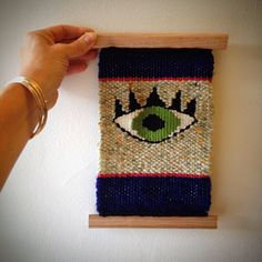 Green eyed monster wall hanging weave by Kym Lightfoot
