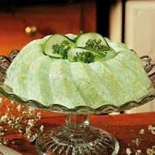 Cool Cucumber Salad Peel,halve,seed & thinly slice.Mix 1/2Cboiling water with jelly/gelatine.Add 1C mayo & 1C cream cheese,salt & pepper. Mould refrig.till set. Unmould & decorate with cucumber & parsley