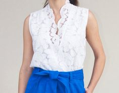 Versatile and classy! This blouse has cross front snap closure, tucking details at shoulder and scalloped edge collar. Fully lined with elastic at the waist. Can be worn tucked in or out.  This item is cut to order, please allow 2 weeks for production. Contact seller for details.  **NOSTALGIC BOUTIQUE IS MISSY SIZING, NOT JUNIORS** Juniors sizing is comparable to Forever21, Missy sizing is comparable to Anthropology. Available in sizes x-small, small, medium, large, and x-large. Missy sizes…