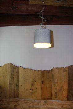 spalliera panca con profilo vette catena M.Bianco...lampada in pietra..progetto realizzato da Christine Pennemann