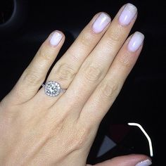 The secret to an enviable engagement ring photo isn't about the background or even the rock itself, at least not entirely: it's about having the perfect polish color or manicure to go with your sparkler, like this Pastel Purple