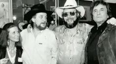 June Carter Cash, Waylon Jennings, Hank Williams Jr. and Johnny Cash. A whole LOT of amazing-ness standing together!!