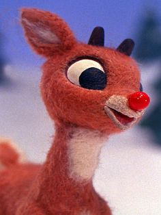 """Rudolph, """"the most famous reindeer of all,"""" was born over a hundred years after his eight flying counterparts. The red-nosed wonder was the creation of Robert L. May, a copywriter at the Montgomery Ward department store. In 1939, May wrote a Christmas-themed story-poem to help bring holiday traffic into his store. Rudolph's message—that given the opportunity, a liability can be turned into an asset—proved popular. Montgomery Ward sold almost two and a half million copies of the story in…"""