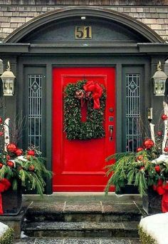 Beautiful red door with decorations for Christmas
