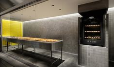<p>Conceived by Yota Kakuda, the Japanese store redefines an idea of a bakery. Selling cheese tarts, the store was designed to remind a factory. With aluminium tiles covering the walls and steel furni