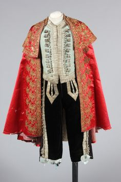 Embroidered rose satin matador cape, late 19th century, couched and embroidered in gold thread and spangled with sequins; together with a black velvet and silver braid matador outfit, comprising blue silk waistcoat, breeches and jacket, Kerry Taylor Auctions Fancy Costumes, Student Fashion, Jacket Style, Cape, Kimono Top, Textiles, Silk, My Style, Black Velvet