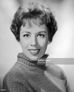 Headshot portrait of American actor and comedian Carol Burnett wearing a turtleneck sweater.