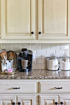 Warm white kitchen with subway tile backsplash.