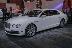 2015 Detroit Auto Show. Bentley Flying Spur Sedan. The most affordable Bentley sedan. Available powertrains include a 4.0-liter twin-turbo V-8 with 500 hp and 487 lb-ft or a 6.0-liter twin-turbo W-12 with 616 hp and 580 lb-ft. An eight-speed auto sends power to all four wheels. V-8 can reach 60 mph in 4.9 seconds and has a top speed of 183 mph, W-12 can reach 60 mph in 4.3 mph with a top speed of 200 mph.