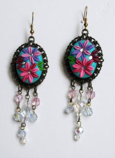 Polymer clay earrings, vintage style. Flower design and antique bronze base. on Etsy, $25.00
