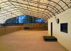 Two indoor arenas, a horse walker and internal stabling, all under a Coverall roof structure.