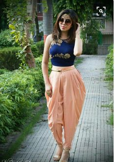 6 Different Outfit Ideas To Style Your Dhoti Pants With In 2018 Dhoti pants are high on trend right now! Here are 6 different outfit ideas to style for dhoti pants with. Indian Fashion Dresses, Indian Gowns Dresses, Dress Indian Style, Indian Designer Outfits, Designer Dresses, Fashion Outfits, Pakistani Clothing, Abaya Style, Punjabi Fashion
