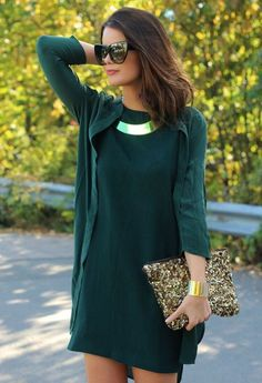 Street style | Deep green long sleeves dress with sequined clutch and golden statement necklace