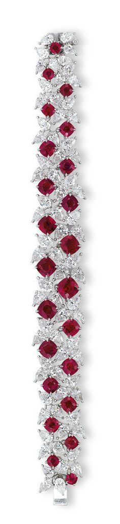 A RARE RUBY AND DIAMOND BRACELET, BY FAIDEE  The highly articulated pear-shaped diamond bracelet interspersed with twenty-three cushion-shaped rubies weighing approximately 23.21 carats total, the reverse accented by brilliant-cut diamonds, mounted in platinum, 17.0 cm long, in black Faidee case Signed and with maker's mark for Faidee #diamondbracelet