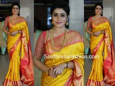 Actress Poorna attended Bhavana and Naveen's wedding wearing a yellow pattu saree that has pink and gold zari borders paired with pink elbow length sleeves stone work blouse. She finished off her look with traditional gold jewellery! Pattu Sarees Wedding, Indian Bridal Sarees, Silk Sarees, Kanjivaram Sarees, Bridal Lehenga, Saris, Party Looks, Pink Saree Blouse, Pattu Saree Blouse Designs