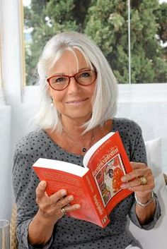 Opera singer Kristen Vaupel at 68, enjoying a book and looking beautiful! https://www.seniorly.com/resources/articles/lifelong-learning-practices-proven-to-enhance-later-years