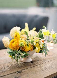 Golden yellow poppy centerpiece: http://www.stylemepretty.com/2016/05/31/yellow-rustic-durham-ranch-wedding/ | Photography: Jose Villa - http://josevilla.com/