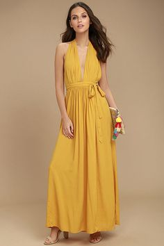 Lulus Exclusive! Each step and sway in the Magical Movement Mustard Yellow Wrap Maxi Dress will bring a compliment your way! Lightweight woven rayon starts at an elasticized halter neckline, with wrapping triangle bodice, then carries into the maxi skirt. Open back and tying sash belt at the waist.