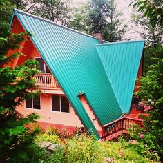A-frame roof with cut-out entryway.