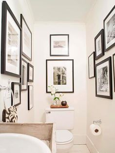 This is a wonderful idea for a small water closet! After: Art-Filled Gallery A fresh weekend bathroom makeover will take your bathroom from blah to beautiful in just two days. Learn how to make over your bathroom with easy DIY updates. Small Downstairs Toilet, Small Toilet Room, Downstairs Cloakroom, Guest Toilet, Bad Inspiration, Bathroom Inspiration, Wc Decoration, Ideas Baños, Decor Ideas