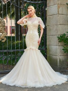 You'll be collecting notes from secret admirers right and left when you don the High Neck Cap Sleeves Appliques Sheer Back Wedding Dress! It's your dream, right?