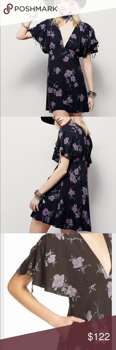 1 HR SALEFree People Melanie print mini dress NWT! Beautiful night combo (black and purple) with side pockets and hidden side zip.  Last one, size 4. Free People Dresses Mini