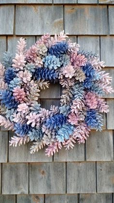 19 wreath with blues, pale pinks, Grey and stone colors.