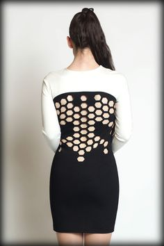 Dress made from thick black and white ponti fabric with hexagons laser cut out of the back!  Sizing: this item runs a tiny bit big. If you are in between sizes or you like your clothing worn tighter, please order one size down.