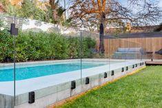 Brighton - The Garden Company Backyard Pool Designs, Swimming Pools Backyard, Pool Decks, Pool Landscaping, Glass Pool Fencing, Pool Fence, Pool Pavers, Pool House Plans, Pool Landscape Design