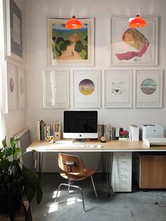 Bools behind the computer, wood desktop, white frames